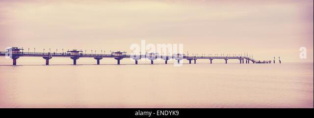 Retro vintage filtered picture of long pier in Miedzyzdroje, Poland. - Stock-Bilder