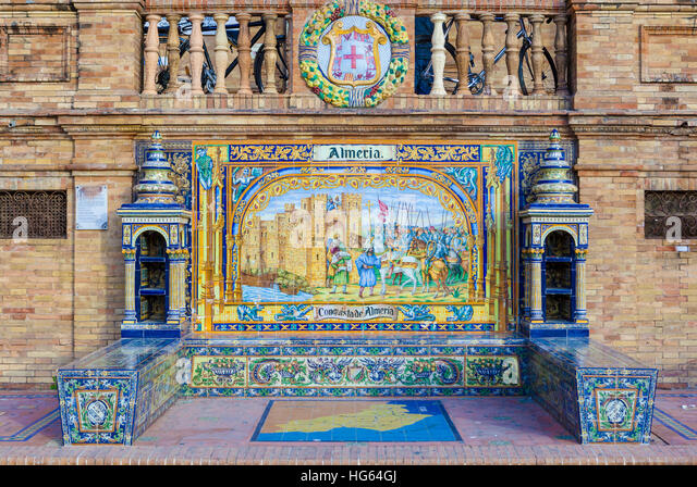 Glazed tiles bench of spanish province of Almeria at Plaza de Espana, Seville, Spain - Stock Image