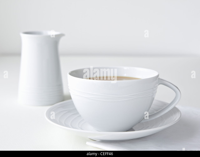 Cup of tea with milk - Stock Image