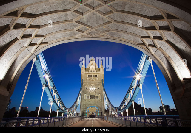 England, London, Tower Bridge illuminated at night from the tower - Stock Image