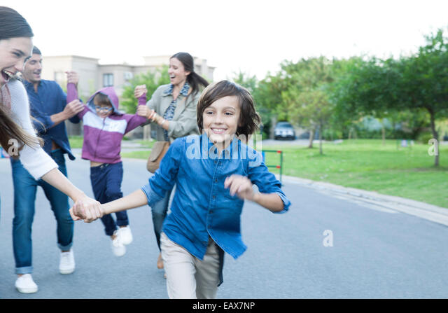 Family playing together outdoors - Stock Image