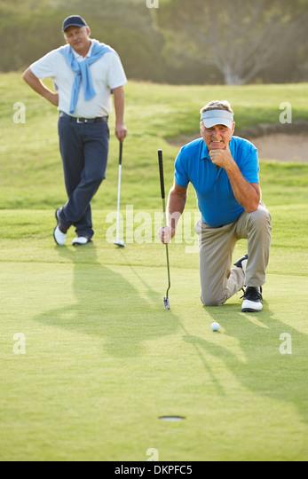 Senior men on golf course - Stock Image
