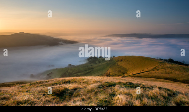 A misty autumnal morning  where Hope valley meets Edale Valley with a view of Win Hill, taken from Lose Hill, Peak - Stock Image