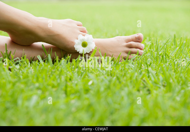 Holding flower between toes - Stock Image