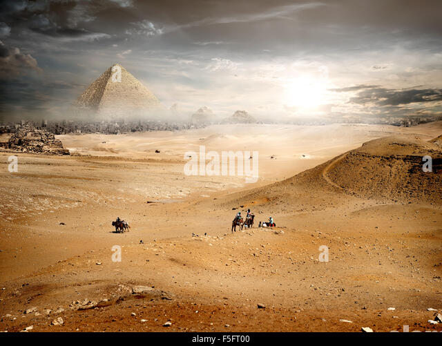 Fog and storm clouds over pyramid in desert - Stock Image
