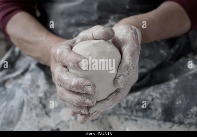 Close-up of female potter's hand holding clay, Bavaria, Germany - Stock Image