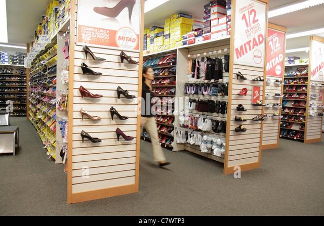Nicaragua Managua Avenida Simon Bolivar Plaza Inter shopping mall Half Price Mitad discount shoe store footwear - Stock Image