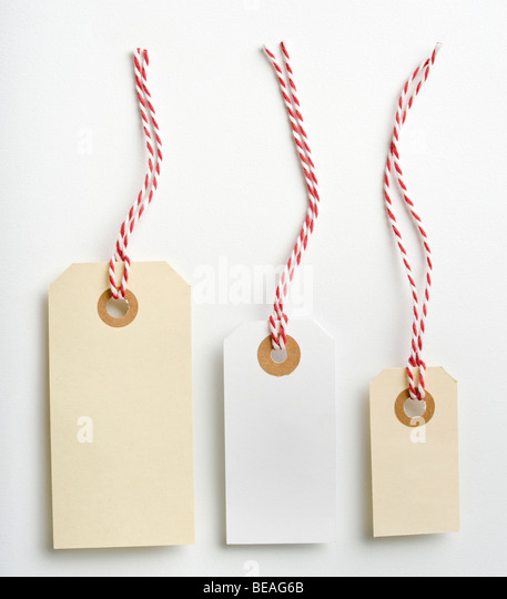 Three labels with red and white rope isolated on white - Stock Image