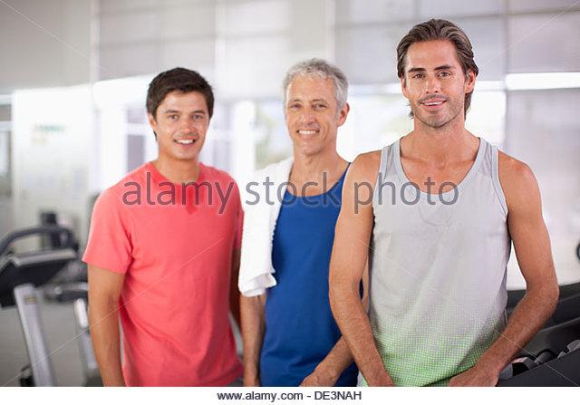 Three men in gym, portrait - Stock Image