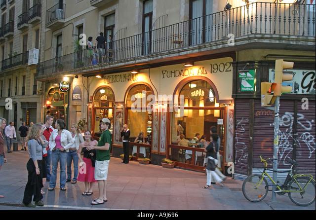Spain Barcelona Las Ramblas Tapa Bar dusk tourists - Stock Image