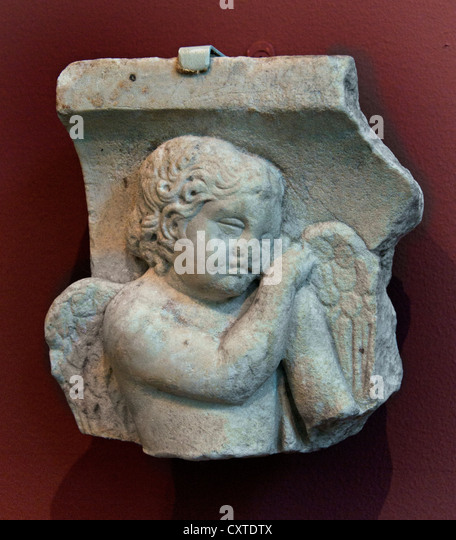 sarcophagus fragment Eros leaning on a reversed torch  Mid Imperial Antonine 2nd century A.D Roman16 cm - Stock Image