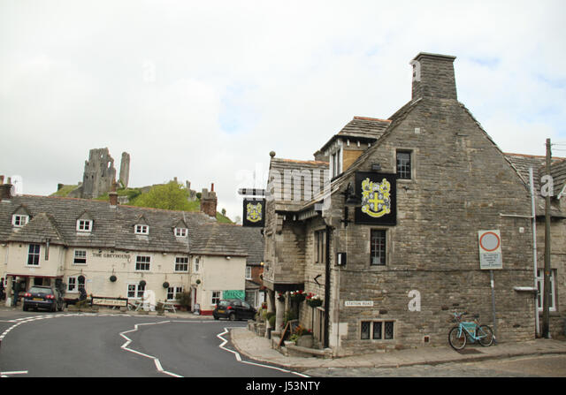 Swanage, UK -  12 May: View of Corfe Castle from East Street in the village on May 12 2017. The village and castle - Stock Image