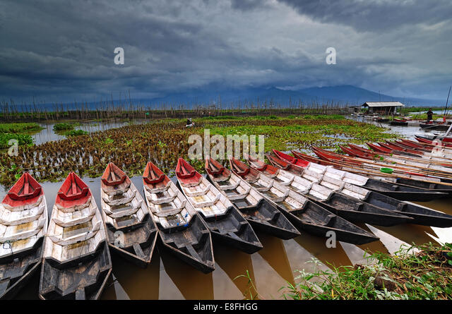 Indonesia, Central Java, Semarang, Wooden kayaks in row - Stock Image