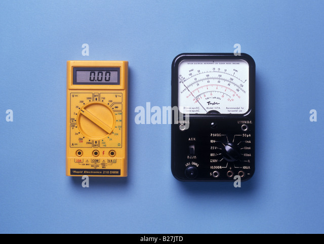 analogue and digital meters side by side - Stock Image