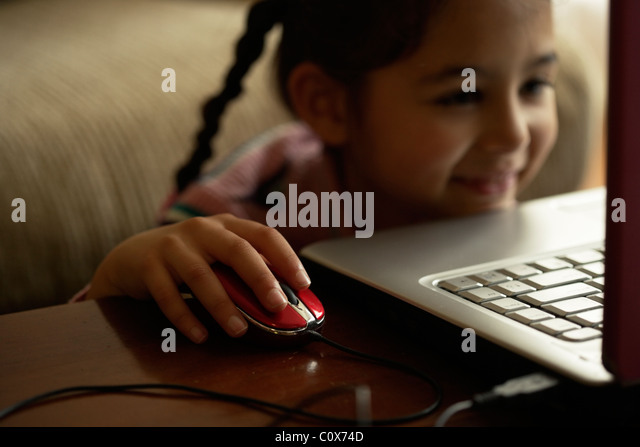 Girl using computer mouse - Stock Image