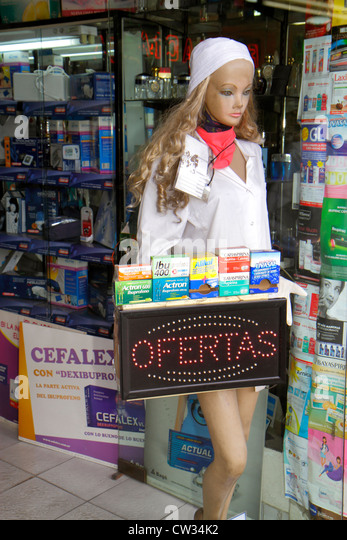 Argentina Buenos Aires Avenida de Mayo pharmacy storefront shopping mannequin for sale special offer medication - Stock Image