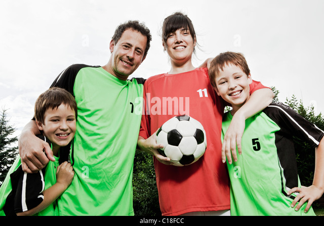 Mother in different team to family - Stock Image