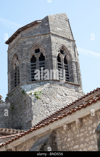 Church with a truncated steeple in a medieval village in the Auvergne, France. - Stock Image