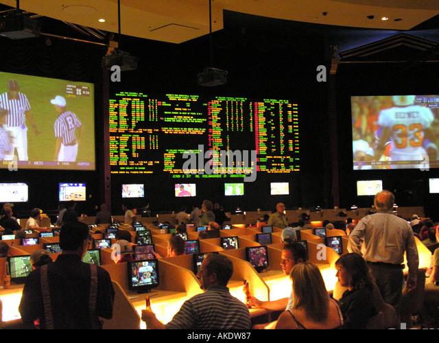 Las Vegas Nevada Caesars Palace sports bar betting parlor football game on monitors - Stock Image