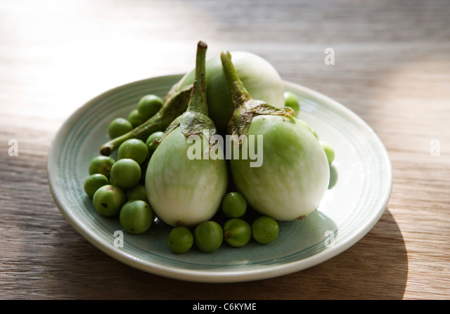 Thai eggplants and limes, ingredients for green curry chicken - Stock-Bilder