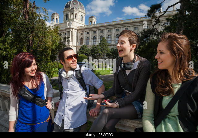 Group of young adults talking - Stock Image