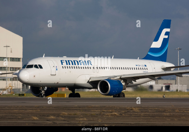 Finnair Airbus A320-214 taxiing for departure at London Heathrow Airport, United Kingdom - Stock Image
