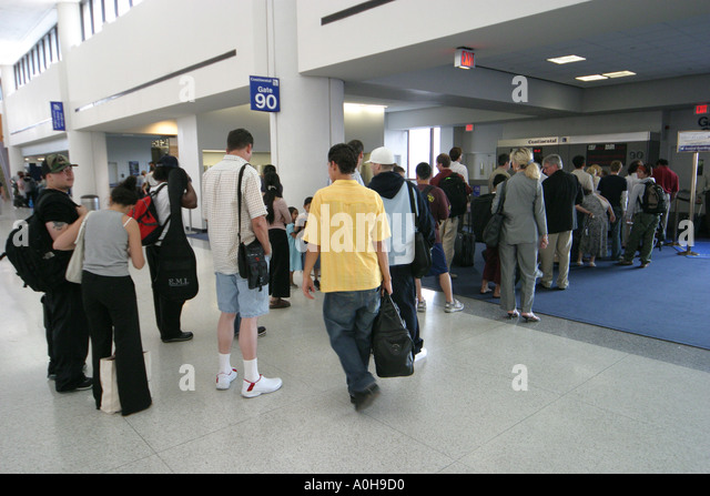 New Jersey Newark Liberty Airport departure gate passengers - Stock Image
