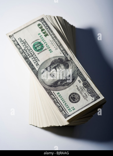 Stack of one hundred dollar bills - Stock Image