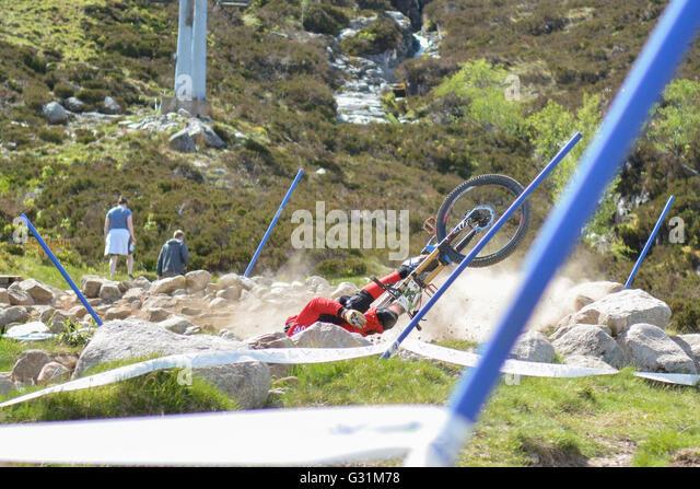 downhill mountain bike crash during race at Glencoe, Scotland, UK - Stock Image