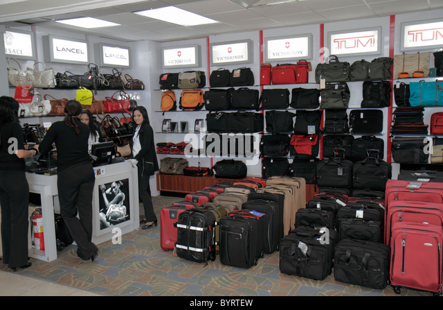 Panama City Panama Aeropuerto Tocumen airport PTY shopping terminal concession luggage shop brand Tumi Lancel Hispanic - Stock Image