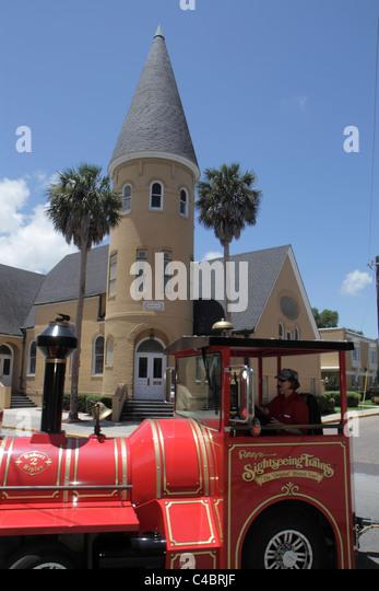 St. Saint Augustine Florida Sevilla Street Ripley's Sightseeing Red Trains Ancient City Baptist Church - Stock Image