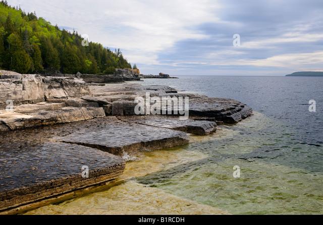 Niagara Escarpment limestone shelves on the shore of Flowerpot Island Bruce Peninsula Ontario - Stock Image