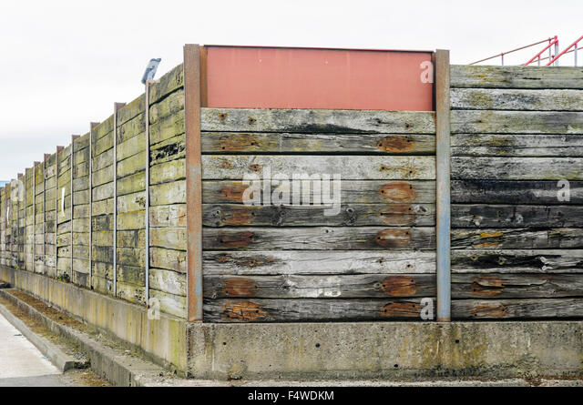 Wooden timber fence at a coal yard - Stock Image