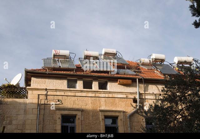 Israel, Jerusalem, Katamon neighbourhood, Solar water heaters on a roof of a house - Stock Image