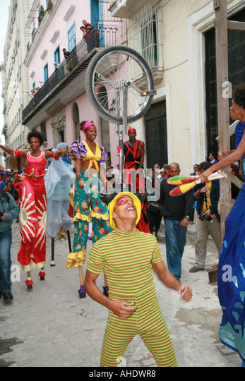 Havana Cuba salsa dancer and jugglers in the street - Stock Image