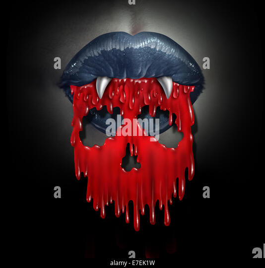 Vampire blood concept as a horror symbol of  bloodthirsty demon lips spilling red liquid shaped as a skull of death - Stock Image