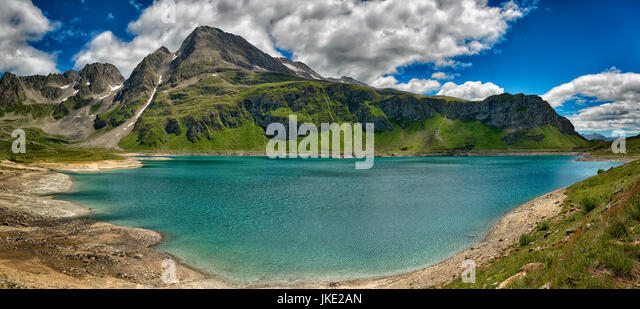 Panorama mountain lake of glacial origin in a beautiful summer day with clouds in the sky - Stock Image