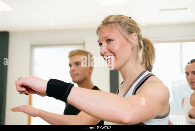Three doing arm movements - Stock Image