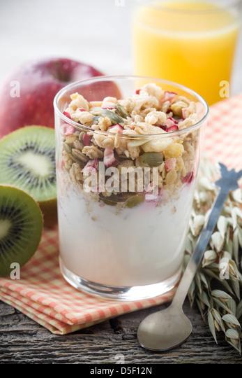 Healthy breakfast with yogurt and muesli, selective focus - Stock Image