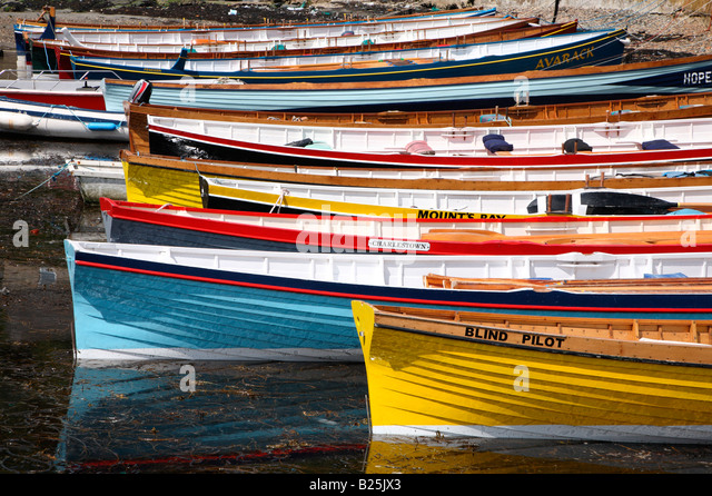 Close up of gig boats lined up in Porthleven harbour, Cornwall UK. - Stock Image