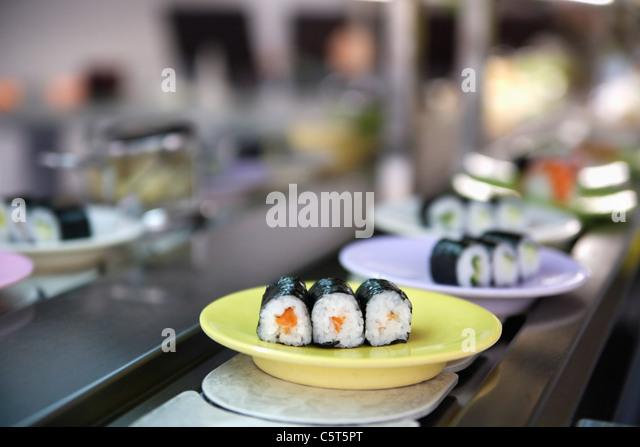 Germany, Munich, Plate of sushi on kitchen worktop, close up - Stock-Bilder