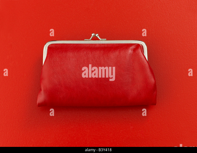 Red coin purse on red background - Stock Image