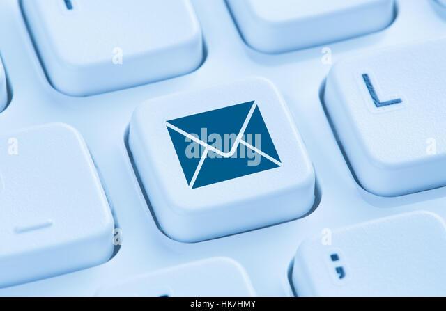 Sending E-Mail email letter internet symbol blue computer keyboard - Stock-Bilder
