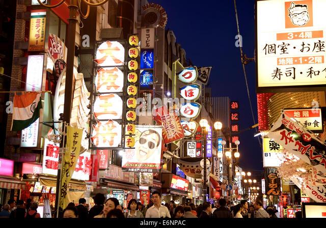 Signs, advertising, billboards, street, people, crowd in Dotombori Arcade, Minami area, Osaka, Japan, Asia - Stock Image