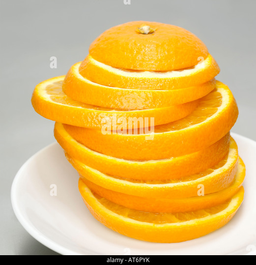 Stacked orange slices, close-up - Stock Image