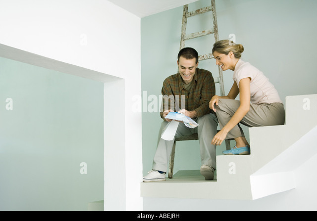 Couple looking at paint swatches - Stock Image