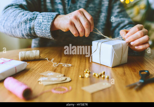 Finland, Man wrapping christmas gifts - Stock Image