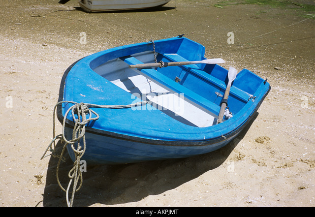 Blue rowboat - Stock Image