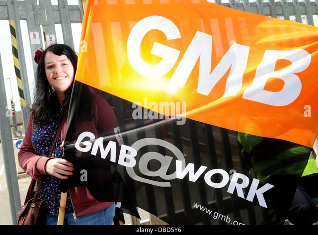A GMB Union Rep at Brighton and Hove City Council on the picket line during a week long strike over proposed pay - Stock Image