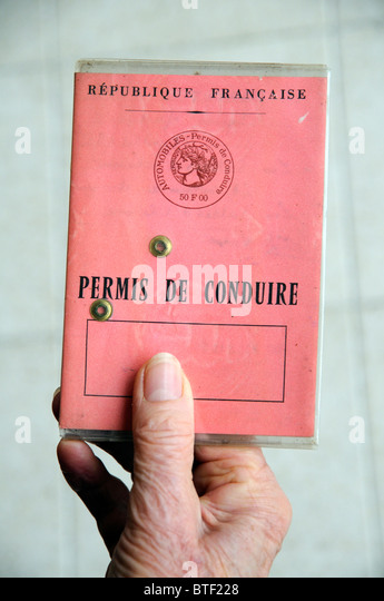 French driving licence being held in a woman drivers hand - Stock Image